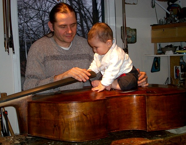 Gerard and son Haru, checking strength of restored Bohemian bass belly